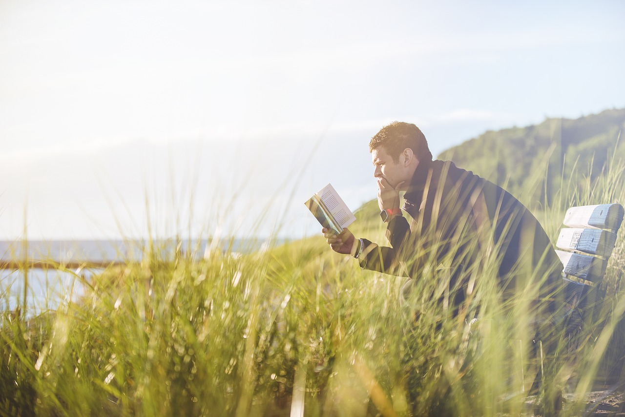 man reading story outdoors